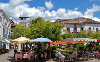 Relax and enjoy a drink from one of the pavement cafes in Orange Square (Plaza de los Naranjos)