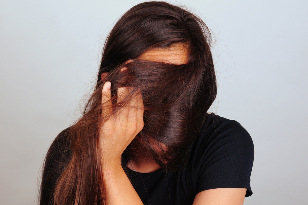 women with hair in her face