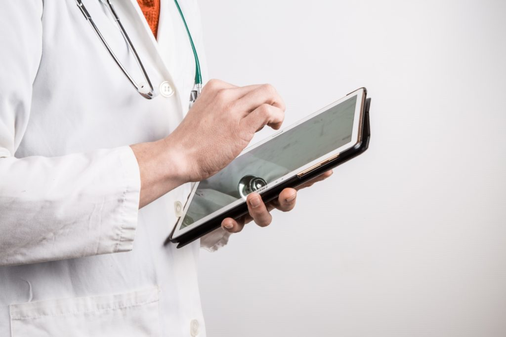 doctor-with-tablet-1461913224a9i